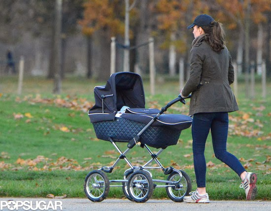 kate walking with Kensington gardens